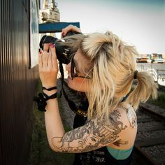 This is probably going to be me someday - with too many tattoos and a camera in hand.