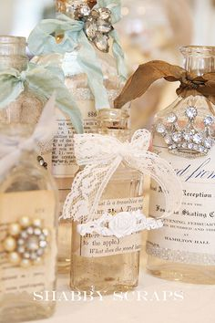 Pretty altered art bottles made up with vintage papers, lace and jewels