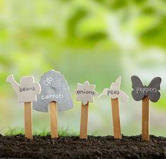 Cute DIY garden markers! Here's how: http://www.midwestliving.com/garden/ideas/15-minute-garden-projects/
