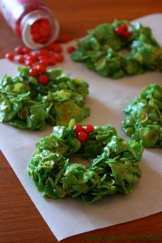 Christmas Wreaths: 1/3 cup butter, 4 cups miniature marshmallows, 1 tsp green food coloring, 6 cups corn flakes, handful of red cinnamon candies.