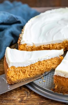 Ultimate pumpkin cheesecake recipe! This rich and creamy pumpkin cheesecake is topped with a layer of tangy sour cream topping.