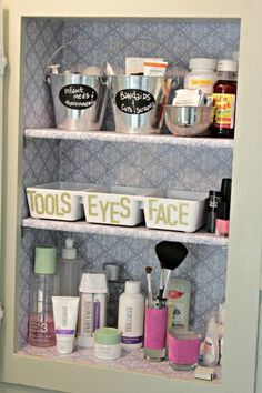 Medicine Cabinet Organization  |  Love the buckets and the wallpaper lining