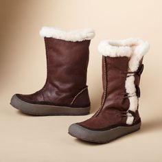 NANOOK OF THE NORTH BOOTS--Hearty style, cozy comfort, in vintage oiled leather, trimmed in shearling sheepskin with an adjustable toggled side gusset. Natural darkgum rubber sole. Imported.