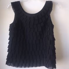 Forever 21 twenty one S small black sleeveless top Twenty one black sleeveless top short blouse. Excellent condition. Layered tile look. Lined. 100% polyester. Love this shirt! I just need to make room as I have too much! Smoke free home. Forever 21 Tops Blouses