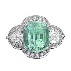 An extremely rare and absolutely stunning Burmese green sapphire takes pride of place in this incredible ring. Weighing 10.26 carats, this cushion-cut, natural jewel exhibits a silky celadon hue and flashes with brilliance thanks to its exceptional clarity and cut. Green sapphires are highly uncommon, and this magnificent gem, from the Mogok region of Burma, is supported by approximately 4.98 carats of diamonds, including two shield-cut diamonds, and is set in luxurious platinum.