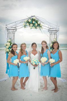Turquoise Beach Wedding-Allure Bridesmaid Dresses www.linpaulsbridal.com. Love the bridesmaids dresses!