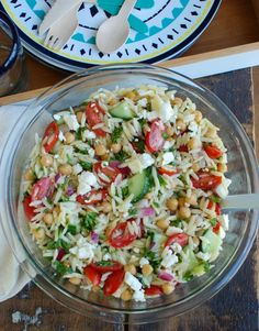 Summer Orzo Pasta Salad is a great addition to any summer get together! This salad mixes together orzo pasta, chickpeas, feta cheese, crisp summer vegetables, fresh herbs and is topped with a light vinaigrette. Your guests are sure to love this one!