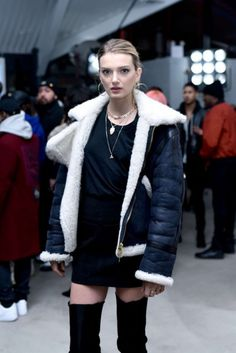 Shearling coat, t-shirt dress and over-the-knee boots street style