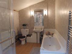 En suite shower room with spa shower & bath