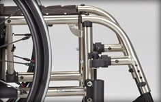 Ki Mobility Catalyst 5Ti -Weighing in at 21lbs the Catalyst 5 Ti is not only incredibly lightweight but the patented frame design provides a ride so incredibly responsive it is sure to not disappoint. No other folding titanium wheelchair offers the combination of lightweight performance that you experience with the Catalyst 5Ti.  http://www.kimobility.com/Product.action?productName=Catalyst+5Ti