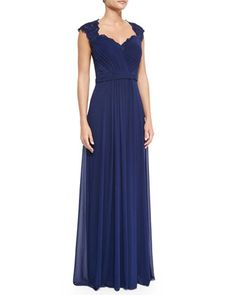 This IS the dress. Perfect for an elegant, evening wedding.   Belted Lace & Chiffon Gown, Navy by La Femme at Neiman Marcus.
