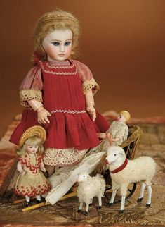 Bread and Roses - Auction - July 26, 2016: 270 Petite Sonneberg Bisque Child Doll with Woven Cart, Tiny Dolls and Toy Lambs