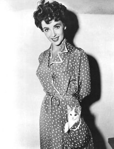 Elizabeth Taylor with a cat in her pocket.