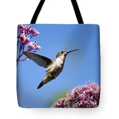 "Modern Beauty Hummingbird Square Tote Bag by Christina Rollo (18"" x 18"").  The tote bag is machine washable, available in three different sizes, and includes a black strap for easy carrying on your shoulder.  All totes are available for worldwide shipping and include a money-back guarantee."