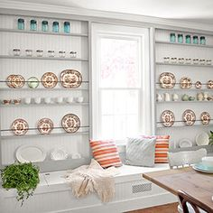 Custom storage with farmhouse flair helps turn back the clock in a lackluster dining room.