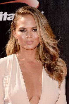 "Fall hair colors- BRONDE ""Beverly Hills based colorist and hairstylist Nelson Chan suggests keeping the highlights off the top of the head, scattering honey-blonde slices around the eyes, cheekbones, and neckline like Chrissy Tiegen."""