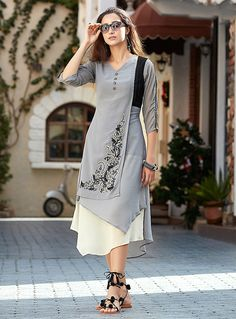 Haute Embroidered Work Faux Georgette Grey Party Wear Kurti Make the heads flip whenever you costume up with this wonderful grey faux georgette party wear kurti. The brilliant dress creates a dramatic canvas with superb embroidered work. Kurti Designs Party Wear, Salwar Designs, Dress Neck Designs, Blouse Designs, Stylish Kurtis Design, Stylish Dresses, Fashion Dresses, Fancy Kurti, Indian Designer Wear