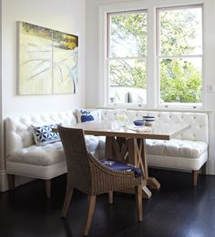 Kitchen Nook // Use a piece of furniture for seating instead of built in seating booth // Breakfast nook with crisp white banquette (via Better Homes & Gardens). Dining Nook, Kitchen Corner, Home, Eclectic Kitchen, Kitchen Booths, Corner Kitchen Tables, Breakfast Nook Bench, Kitchen Benches, Nook Bench