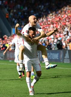 Poland's midfielder Slawomir Peszko and Poland's defender Michal Pazdan celebrate after their victory during the Euro 2016 round of sixteen football. Robert Lewandowski, National Football Teams, World Football, Poland, Victorious, Euro, Soccer, France, Running