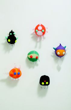 Electrophauns by Ryan Marsh Fairweather of Bee Kingdom. Approx the size of a softball, wall mounted.