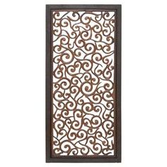 """Bring a pop of pattern to an accent wall or mantel vignette with this scrolling openwork wall decor, an artful touch for your home.  Product: Wall decorConstruction Material: Mango wood and engineered woodColor: Brown frameDimensions: 51"""" H x 24"""" W x 1"""" D"""