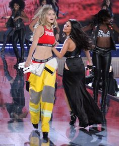 Old friends: Gigi Hadid, 20, danced with her friend Selena Gomez, one of the musical guests