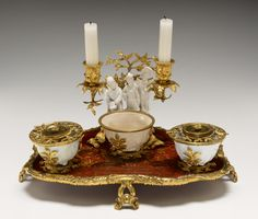 Inkstand (Encrier); Unknown; probably Paris, France; porcelain early 1700s - before 1750; lacquer early 1700s - about 1750; mount abo; Hard- and soft-paste porcelain; coral tree wood with Asian lacquer; gilt-bronze mounts; 20.3 x 35.6 x 26.7 cm (8 x 14 x 10 1/2 in.); 76.DI.12