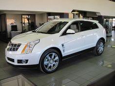 Cadillac SRX:    Yes, please.                              (thank you:))    Google Image Result for http://www.royalcityfinecars.com/wp-content/uploads/2010/12/2010-Cadillac-SRX-white-1-630x472.jpg