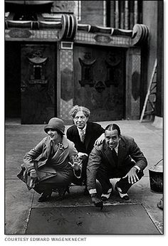 April 30, 1927:  Mary Pickford & Douglas Fairbanks become the first celebrities to leave footprints at Grauman's Chinese Theatres