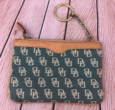Find many great new & used options and get the best deals for Dooney & Bourke Signature DB Zippered Coin Purse Pouch at the best online prices at eBay! Free shipping for many products! Brown Leather Purses, Dark Brown Leather, Clutch Wallet, Pouch, Tote Backpack, Purses For Sale, Canvas Leather, Tote Handbags, Dooney Bourke