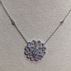 An elegant diamond swirl design necklace with 1.21ctw! Just for you, at Becker's.