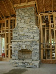 dry stack stone fireplace - arch