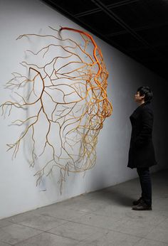 Drawn by Life is the name of this series of works by artist Kim Sun Hyuk Korean. Are plant roots sculptures made of stainless steel which have the appearance of blood vessels forming images of human body parts.