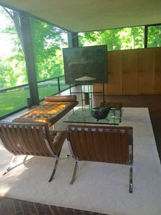 The living area is filled with Mies Van Der Rohe's Barcelona series furniture. He designed this now famous daybed specifically for Johnson.
