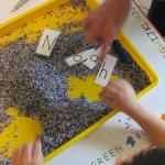 Digging up the letters of our name in preschool