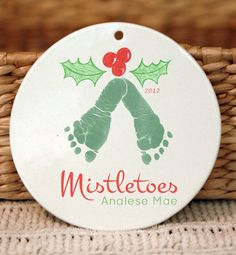 """This keepsake is made from your loved one's actual hand and footprints! You can customize this keepsake by changing the personalization, fonts, and colors. Please include your customization in the """"notes to seller"""" section when ordering. Keepsake Description: Sleek and beautiful ornament, hang on a Christmas tree or on a wall for year round enjoyment Ornaments are hand-cut, and size will vary slightly. Approx measurement is 4 round Complimentary twine ribbon included for hanging Kiln fired…"""