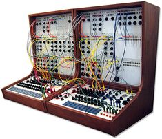 Buchla music synthesizer | modular 100 series, 1963 - 1970 | The system usually consisted of a large wood case with room for a bunch of modules (up to 25 modules on a single power-supply)