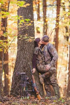 "AWESOME engagement photo!!! Would be so cute with the ""save the date"" hanging from a stuck arrow in the tree!!!"