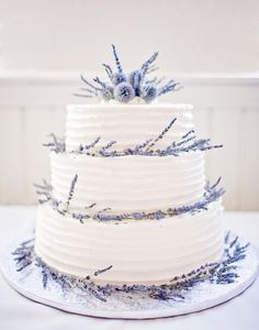 Combed icing gives this simple white wedding cake a rustic feel. Lavender and globe thistle complete the look. | Photo by Rachel Havel #cake #lavender #globethistle