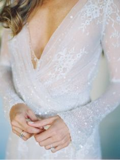 Sparkly Wedding Dress: You might think that bride style with sparkle has to be dramatic, but this bride's shimmer is soft and elegant. The white sequins on this flowy romantic dress add an ethereal vibe. | Gorgeous Bride Style with Extra Sparkle
