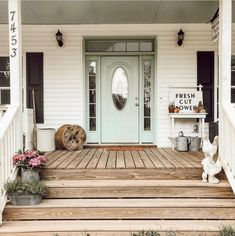 has the most inviting front porch - we LOVE our Fresh Cut Flowers sign styled here! has the most inviting front porch - we LOVE our Fresh Cut Flowers sign styled here! House With Porch, House Front, My House, Future House, Farmhouse Style, Farmhouse Decor, Building A Porch, Outdoor Lighting, Outdoor Decor