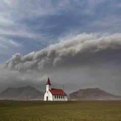 Icelandic church with Eyjafjallajökull ash cloud in the background