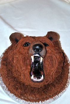 Grizzly bear groom's cake - 3D grizzly bear cake. Cake was chocolate with chocolate mousse filling. All the features were made from fondant. Chocolate buttercream icing created the fur.