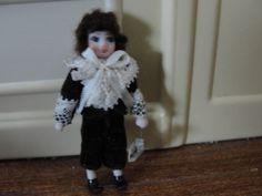 "Ethel Hicks, Angel Children 2"" porcelain boy doll wearing a brown  velvet suit with ecru lace trim; sold on ebay for $20.50"
