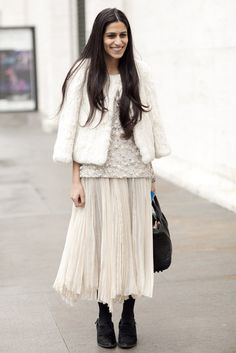 Anahita Moussavian (New York Post) in fur jacket over beaded top and pleated chiffon maxi skirt with black tights and ankle boots   New York Fashion Week Street Style Fall 2012, Photography by Greg Kessler #blackandwhite #streetstyle