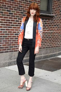 Swoon! Another expertly paired ensemble, courtesy of Florence Welch . The star teamed a kimono-style jacket with a pussybow blouse and a pair of colour block heels.
