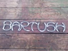 I will write your last name, first name or anything that you want to say out of horseshoes. Different sized horseshoes are used to make all