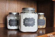 You don't need to spend a lot of money on flour and sugar containers. Here's how to make your own using chalkboard stickers to label the glass jars.