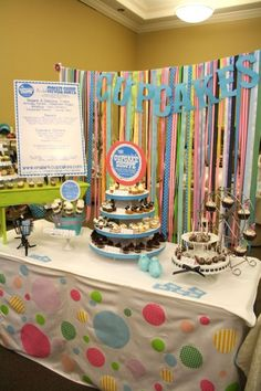 Pretty streamers as a backdrop to this cupcake booth