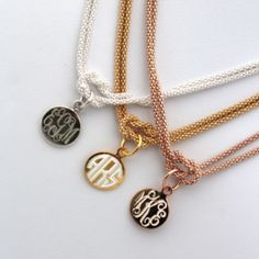 The Square Knot Monogram Necklace in Italian sterling silver with a thick plating of gold or rose gold. When engraved, the silver peeks through for a stunning effect.